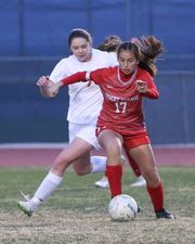 Desert Mirage's dribbles the ball against Big Bear